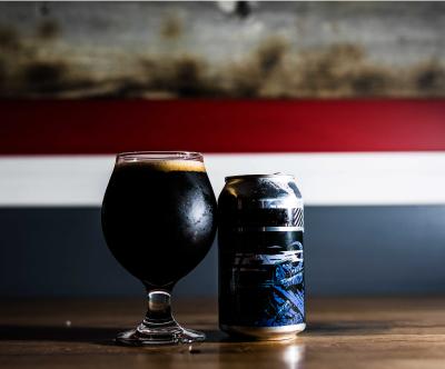 cerveza negra lata